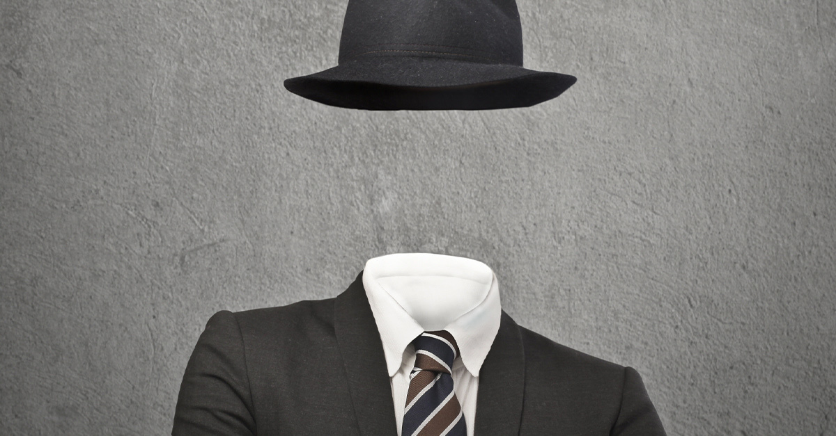 Invisible man in a business suit and hat