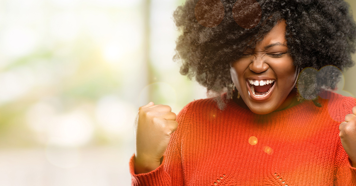 Business woman expressing joy with pumped fists and big smile