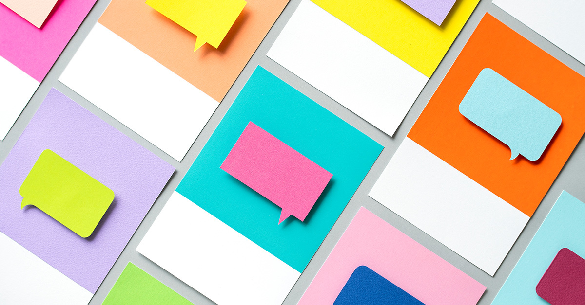 Colorful chat bubbles against background of bright color blocks indicating communication