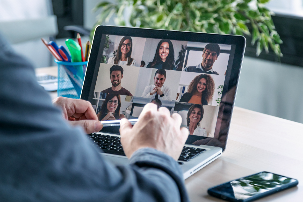 Male employee speaking on video call with diverse colleagues on online briefing with laptop at home. stock photo Spain, Working At Home, Video Call, Teamwork, Meeting